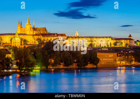 Night on the River Vltava with Prague Castle in the distance. Czech Republic - Stock Photo