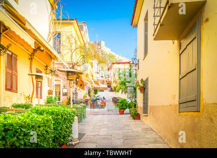 small cosy street of famous Placa old town district in Athens, Greece, toned - Stock Photo