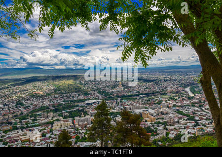 Panorama view of Tbilisi, capital of Georgia country. View from the mountain - Stock Photo