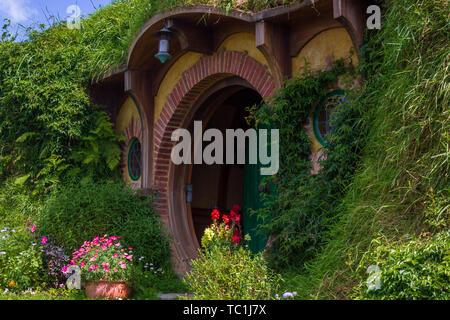 bilbo baggins home and hobbit garden in hobbiton movie set, new zealand. Taken during summer - Stock Photo