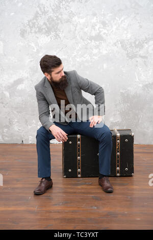 Time traveller concept. Vintage inspired design of bag. Retro and vintage. Follow your dream. Accessories for vacation. Best travel bags for men. Well groomed elegant bearded man and vintage suitcase. - Stock Photo