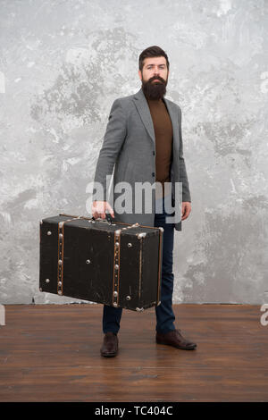 Retro and vintage. Fashion trend. Accessories for vacation. Best travel bags for men. Guy well groomed elegant bearded man and vintage suitcase. Time traveller concept. Vintage inspired design of bag. - Stock Photo