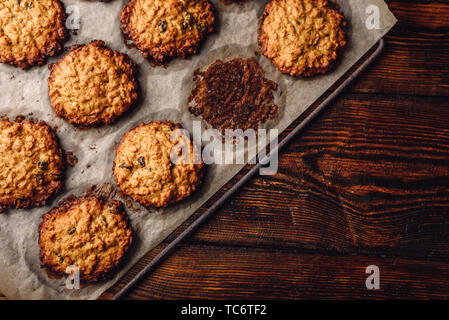 Homemade Oatmeal Cookies with Raisins on Parchment Paper. View from Above. - Stock Photo