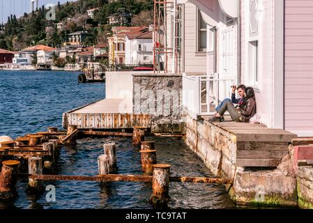 Young couple watch Bosphorus,Rumelian Castle and Fatih Sultan Mehmet Bridge view from, Anatolian (Asian) side of Bosporus in Istanbul,Turkey. 15 - Stock Photo