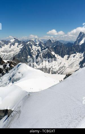 Views from LA'Aiguille Du Midi in Chamonix, France. In the image climbers ascending Mont Blanc with an official altitude of 4810. 06 meters. It is - Stock Photo