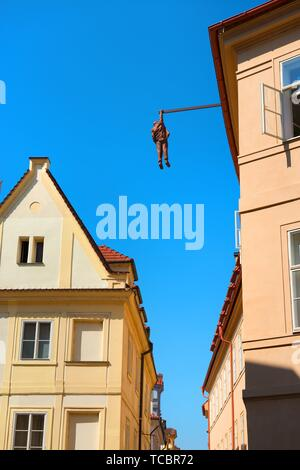 PRAGUE, CZECH REPUBLIC - July, 2018: Sculpture of the psychoanalyst Sigmund Freud hanging by a hand called Man Hanging Out created by the artist - Stock Photo
