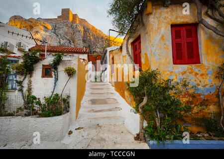 Anafiotika neighborhood and Acropolis in the old town of Athens, Greece.. - Stock Photo