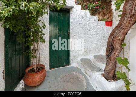 Old houses in Anafiotika neighborhood in the old town of Athens, Greece.. - Stock Photo