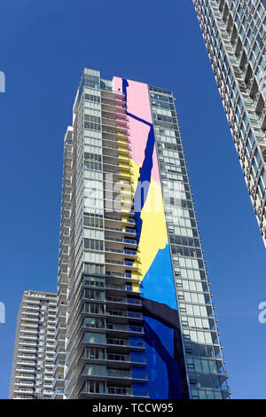 Modern residential towers including The Charleston  with its colorful 416 foot high abstract mural in Yaletown, Vancouver, BC, Canada - Stock Photo