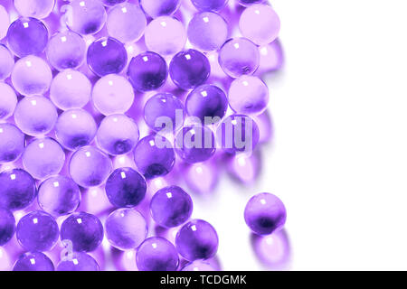 proton purple spherical ball capsules with selective focus isolated on white background - Stock Photo