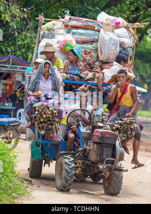 Burmese farmers riding on an old tractor in a village in Shan state Myanmar - Stock Photo