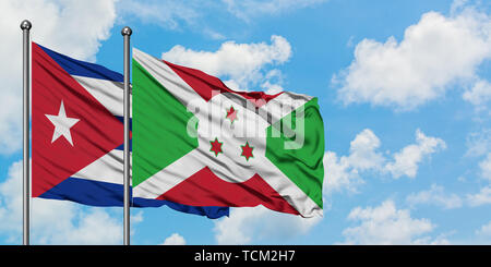 Cuba and Burundi flag waving in the wind against white cloudy blue sky together. Diplomacy concept, international relations. - Stock Photo