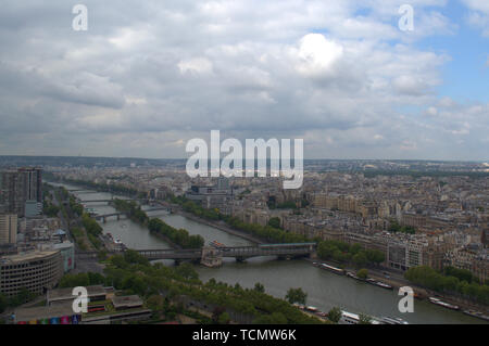 View of the city of Paris, the Seine river and the Island of the Swans, from the second platform of the Eiffel Tower, heading west. - Stock Photo