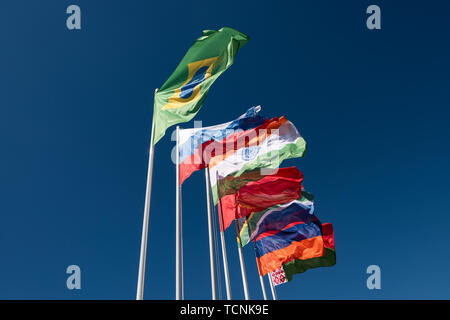 Flags of the BRICS countries in the blue sky - Stock Photo