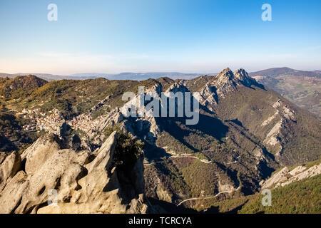 Landscape of Dolomites of Basilicata mountains called Dolomiti Lucane.  In the background Castelmezzano village. Basilicata region, Italy - Stock Photo