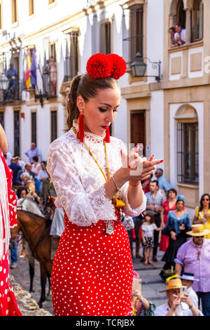 CORDOBA, SPAIN - MAY 30, 2019: Female flamenco singer sings in front of the Mosque-Cathedral at Feria de Cordoba, Feria de Nuestra Senora de la Salud  - Stock Photo