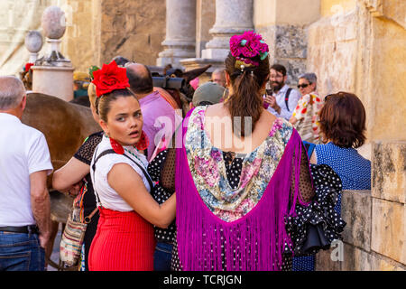 CORDOBA, SPAIN - MAY 30, 2019: Beautiful dressed female participants at Feria de Cordoba, Feria de Nuestra Senora de la Salud or Cordoba Fair - Stock Photo