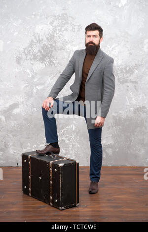 Time traveller concept. Vintage inspired design of bag. Retro and vintage. Fashion trend. Accessories for vacation. Best travel bags for men. Guy well groomed elegant bearded man and vintage suitcase. - Stock Photo