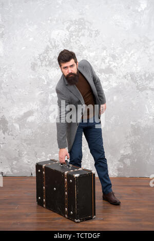 Vintage inspired design of bag. Retro and vintage. Fashion trend. Accessories for vacation. Best travel bags for men. Guy well groomed elegant bearded man and vintage suitcase. Time traveller concept. - Stock Photo