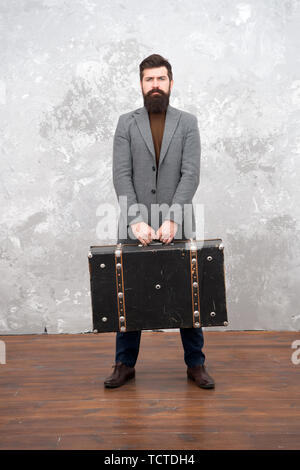 Fashion trend. Accessories for vacation. Best travel bags for men. Guy well groomed elegant bearded man and vintage suitcase. Time traveller concept. Vintage inspired design of bag. Retro and vintage. - Stock Photo