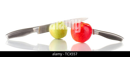 Red, green apples with knives isolated on white - Stock Photo