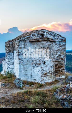 Exterior apse view of the medieval non-functioning Church of St. John Letni at Pchelina Reservoir, Western Bulgaria on an August evening - Stock Photo