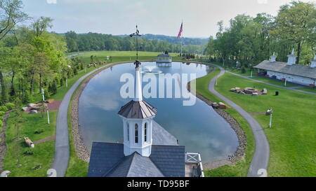 Aerial View of a Steeple or Cupola and Pond as Seen by a Drone - Stock Photo