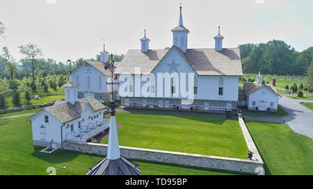 Aerial View of a Old Barns with Steeple or Cupola as Seen by a Drone - Stock Photo