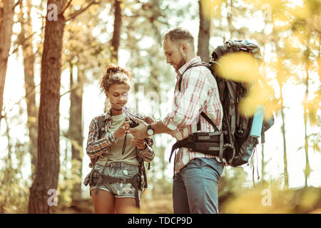 Pleasant young people using their walkie talkies - Stock Photo