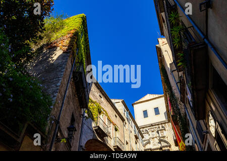 Medieval stone stairs leading to the church of Sant Marti Sacosta in the old town of Girona, Girona landmarks, Catalonia, Spain. - Stock Photo