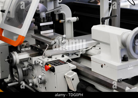 Industrial metal lathe machine close up. Selective focus. - Stock Photo