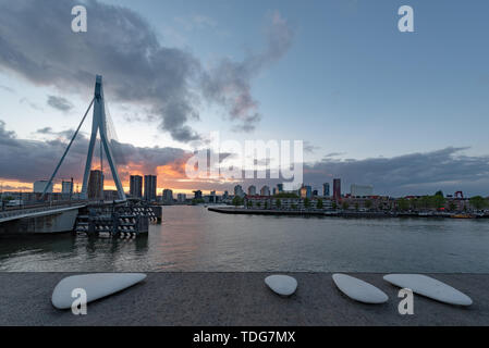 Rotterdam, Netherlands - May 5, 2019 : Erasmus bridge and New meuse river with a beautiful sunset in the background - Stock Photo