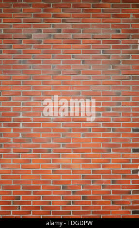 High resolution full frame background of detailed new red brick wall with vignetting. - Stock Photo