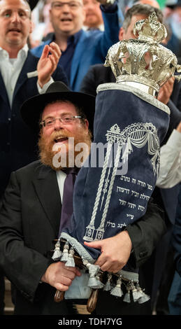 Dresden, Germany. 16th June, 2019. Rabbi Shneor Havlin carries the new Tora role for Dresden from the city hall after the ceremonial inauguration. Credit: Robert Michael/dpa-Zentralbild/dpa/Alamy Live News - Stock Photo