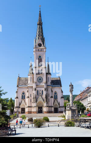 The Jesus' Heart neogothic historicizing Church with the Holy Trinity Sculpture in Kőszeg, Hungary - Stock Photo