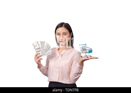 retail commercial business concept, Asian beautiful woman holding banknote money in hand and shopping cart in another hand isolated on white backgroun - Stock Photo