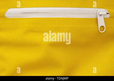 White Zipper in a Yellow Sports Backpack. Zippers Background - Stock Photo