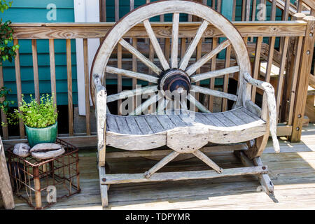 Sanibel Island Florida Bailey Homestead Preserve Sanibel-Captiva Conservation Foundation SCCF rustic wagon wheel wooden garden bench - Stock Photo