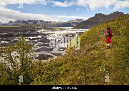 hiker at glacier Svinafellsjoekull in Vatnajoekull National Park, Hornarfjoerdur, Iceland, East Iceland, Vatnajoekull National Park, Svinafellsjoekull - Stock Photo