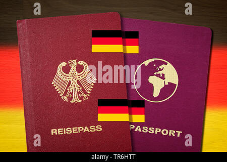 German and other pass in front of german flag, symbol picture for dual citizenship, Germany - Stock Photo