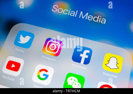 Sankt-Petersburg, Russia, April 1, 2018: Apple iPad with icons of social media facebook, instagram, twitter, snapchat application on screen. Social me - Stock Photo