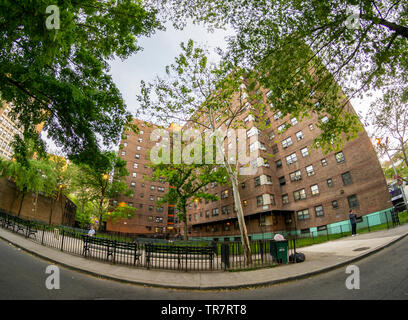 The massive NYCHA Elliot Houses complex of apartments in Chelsea in New York is seen on Tuesday, May 21, 2019. (© Richard B. Levine) - Stock Photo