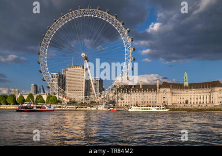 The London Eye, Marriott County Hall and Shell HQ from Westminster Pier Victoria embankment with City Cruises tour boat Westminster London England UK - Stock Photo