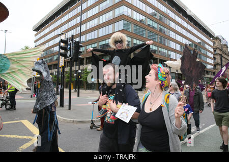 Manchester, UK, 1st June, 2019. 'Rising Up Manchester Families'  celebrate nature and march to raise awareness to the loss of wildlife and the need to act to protect it.  The 'carnival Of Creatures' gathered in All Saints park and marched to Piccadilly Gardens,  Manchester. Credit: Barbara Cook/Alamy Live News - Stock Photo