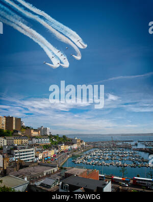 GB - DEVON: RAF Red Arrows Display Team over Torbay with Torquay harbour and town in the foreground. (Torbay Airshow, a two-day event 1st June and 2nd - Stock Photo