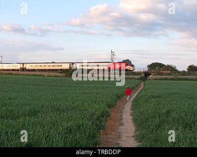 Virgin Class 390 Pendolino Train on the Northampton Loop of the West Coast Main Line on a Sunny Summer Evening - Stock Photo