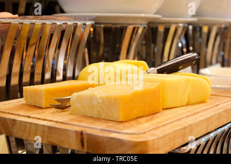 pile of butter on buffet line for breakfast - Stock Photo