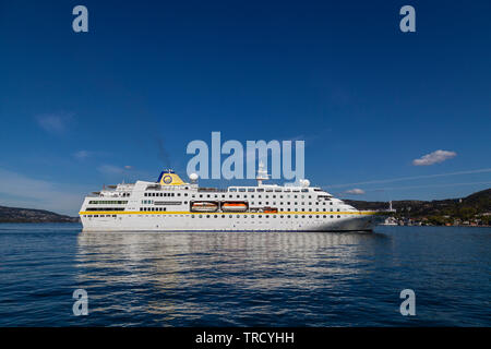 Cruise ship Hamburg approaching the port of Bergen, Norway. - Stock Photo