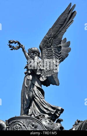 Part of Wellington Arch bronze quadriga sculpture close up of Nike the winged goddess of victory with laurel wreath Hyde Park Corner London England UK - Stock Photo
