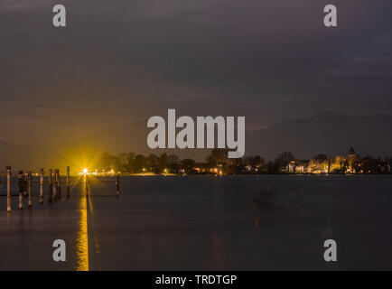 island Frauenchiemsee at night, the Alps in background, Germany, Bavaria, Lake Chiemsee - Stock Photo